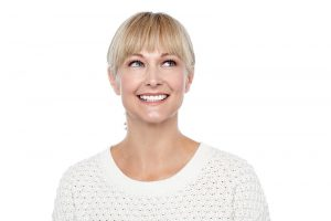 Young blonde woman with bangs smiling