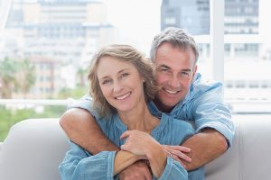 Middle-aged couple smiling and embracing